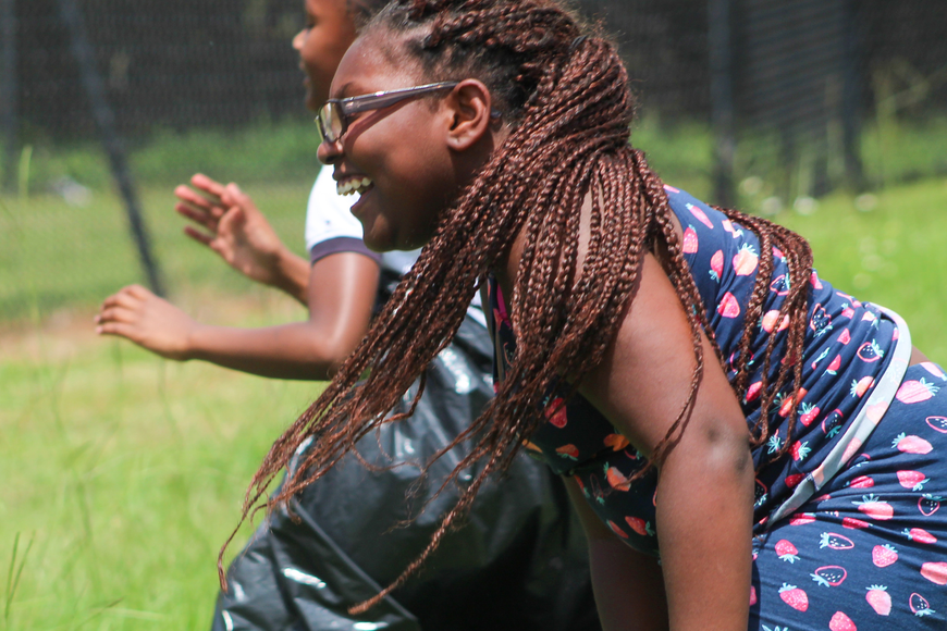 Yazmine McCoy laughed as her friends hopped their way to the sack race finish line.