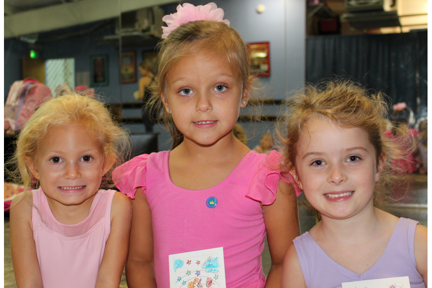 Abigail Fitzgerald, 4; Riley DeHart, 5; and Olivia Smith, 5; took a break from coloring a unicorn puzzle for a picture.