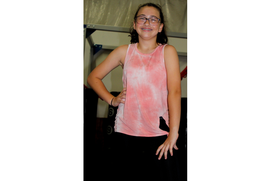 Emma Carroll, 11, couldn't help but laugh as she was getting ready to dance.