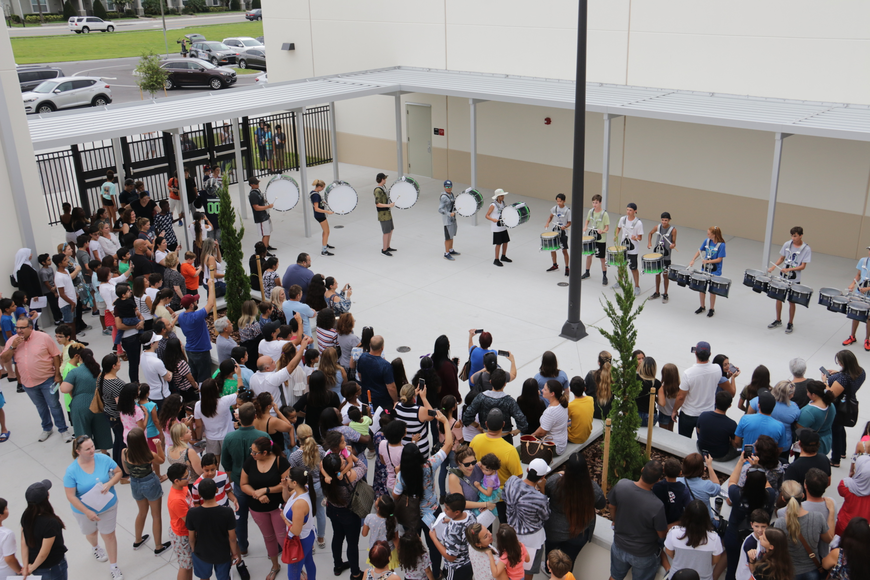 Parents, students and staff gathered in the school courtyard to watch a performance from the Windermere High School drum line.