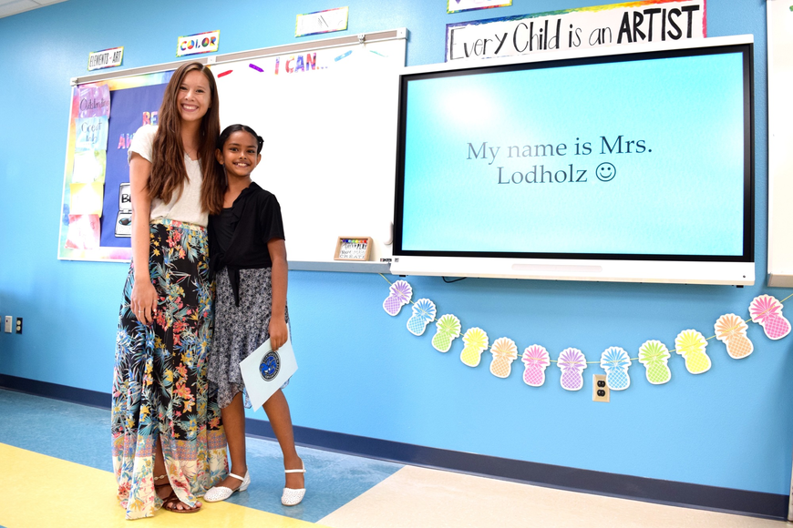 Art teacher Christina Lodholz had great company in rising fourth-grader Tanishka Sankar.