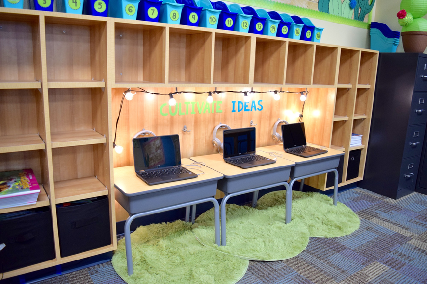 In this classroom, growth is the main theme, and it shows in the student laptop lab.
