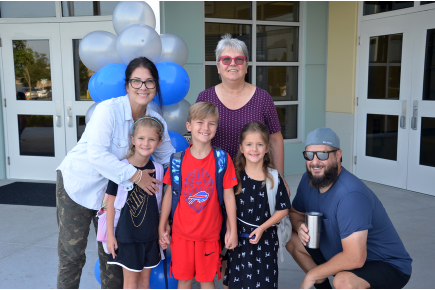 Students Cecilia, Eliza and Emmet Teller gathered together with parents, Beatrice and Jason Teller and grandmother Renate Beil for a last photo before making their way into the school.