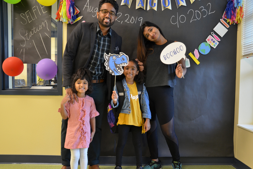 Parents Joel and Savitha and sister Norah walked student Selah George  to her classroom on her first day of  school.