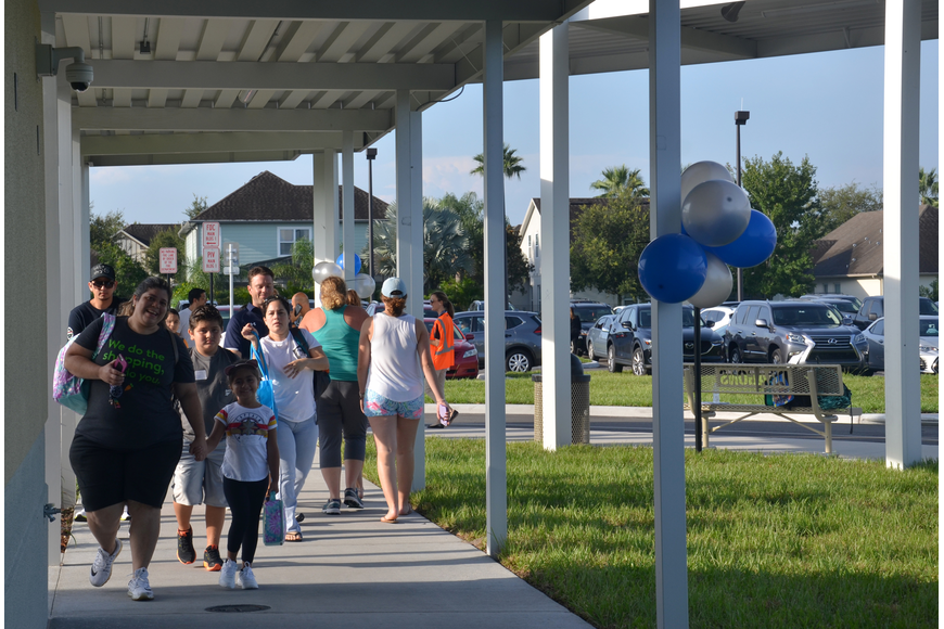 From the times the doors opened on Monday, a steady stream of parents and students made their way into the new building.