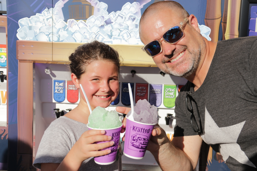 Third-grader Mackenzie Page and her dad, Steve, cooled off with some Kona Ice.