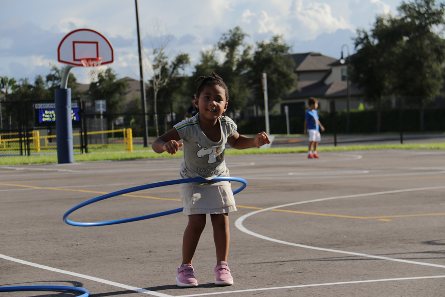 Pre-kindergartener Amyiah Colbourne headed for the hula hoops before grabbing a bite.