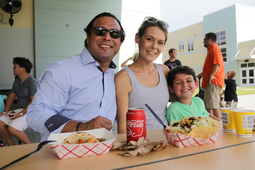 Carlos, Susan and Ricky Castro each got something from a different food truck for dinner.