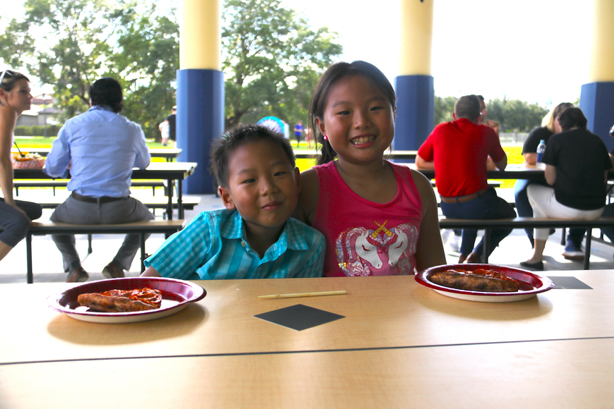 Kindergartener Roy Fang enjoyed some pizza with her sister Candice Yang.
