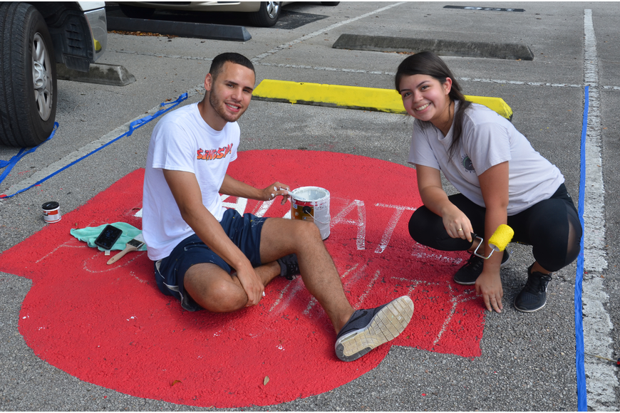 "Josue Ramirez and senior Vivian Ordinola painted Ordinola's spot with a colorful design. When finished, the spot read ""radiate positivity."""