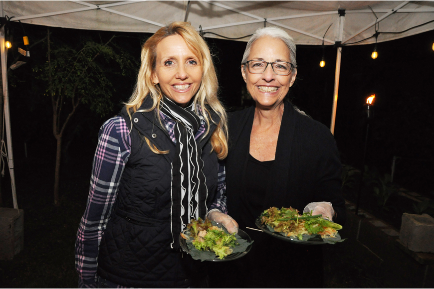 Shelley Benn and Camille Wilson served guests a Thai green papaya salad wrap.