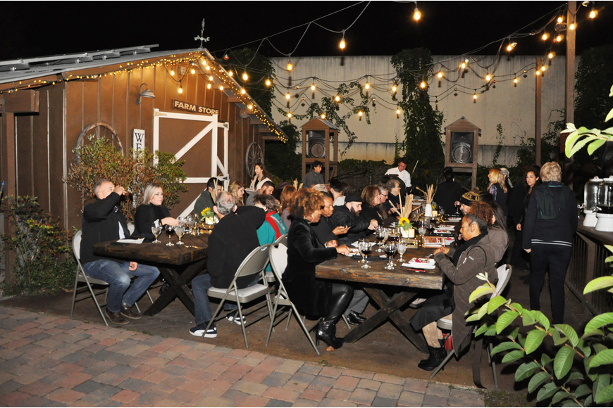 Guests dined at tables under the stars.