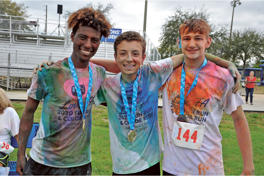 Mehari Van Der Rite, first place; Andrew Nyland, second place; and Matthews Nicoletti, third place, were the top three male runners at Foundation Academy's Love FA 2020 Boosterthon Color Run Friday, Feb. 14. Published Feb. 20.