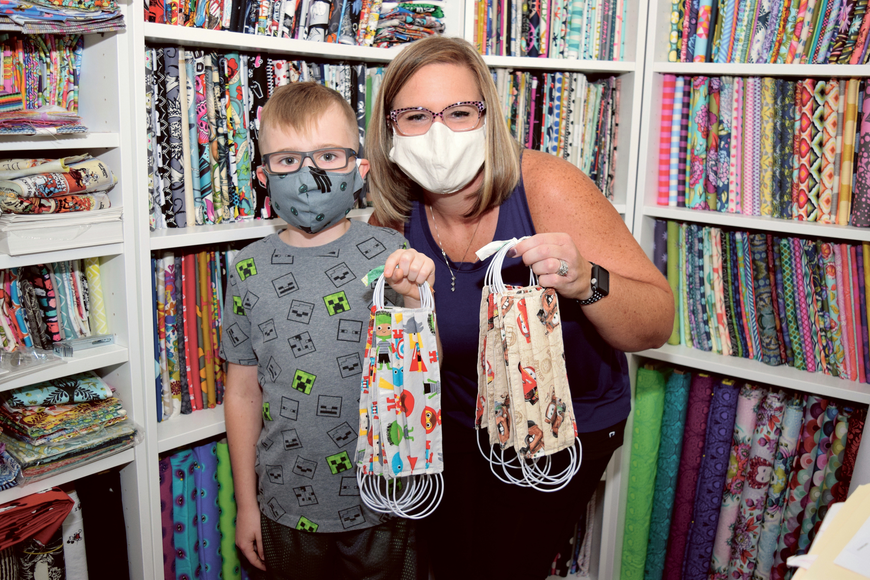 Through the Army of Masks Facebook groups, Erin Morris — pictured with son, Ronan — sewed fabric face masks for those on the front lines of the coronavirus pandemic. Published April 2, 2020.