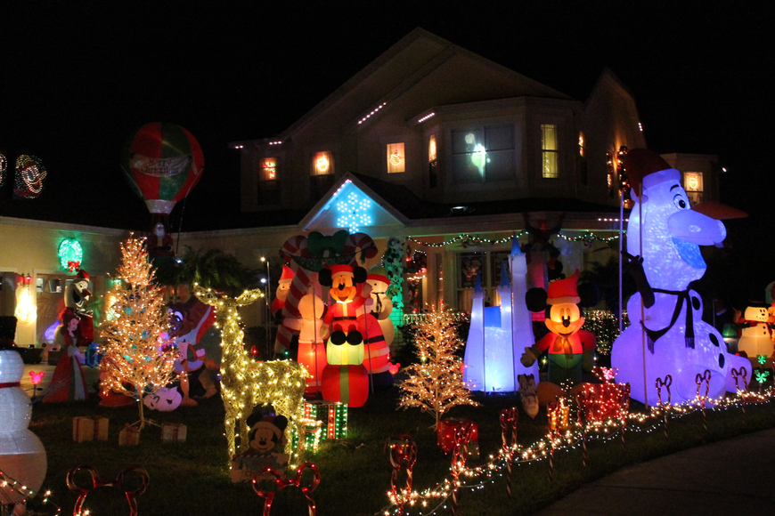 disney themed house in summerport shines for christmas - When Is Disney Decorated For Christmas