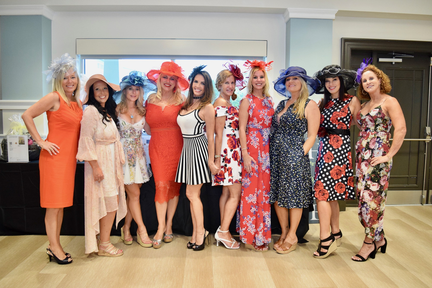 These ladies came dressed in their Kentucky Derby best, hats and all.
