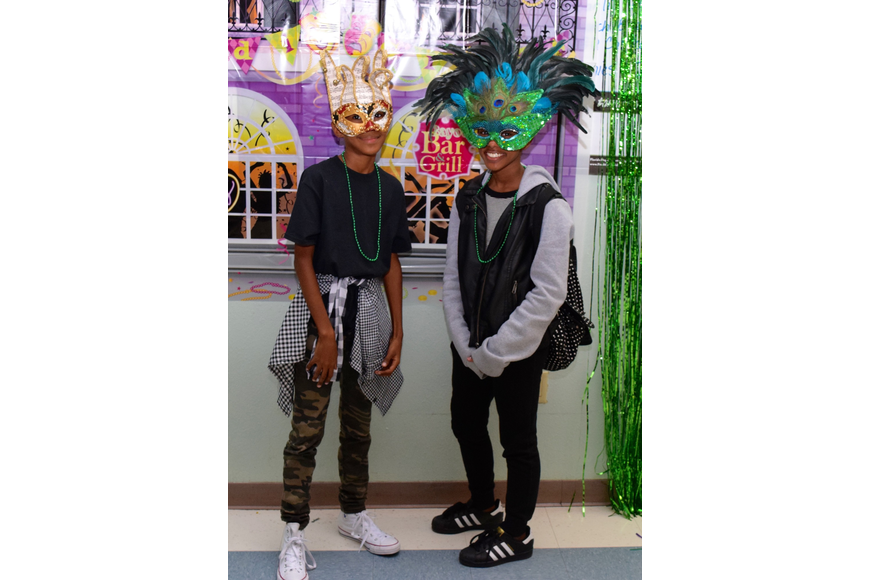 Two students got creative with their sparkly, feather-filled masks.