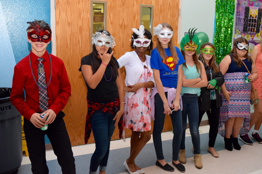 Students stand in line for the mask-judging contest.