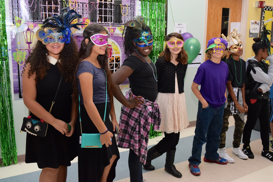 A group of students had fun posing for pictures and showing off their decorated masks.