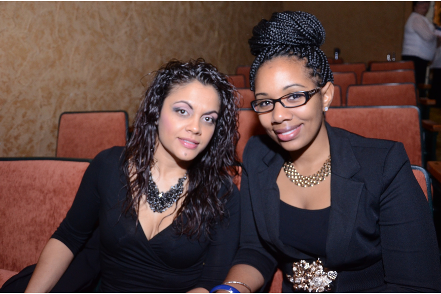Waleska Reyes and Monique Bell relax in the theater.