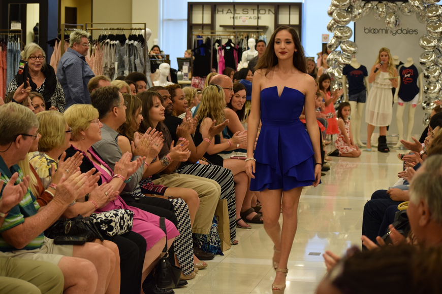 Sofia Delfino rocked the runway in a blue dress and heels.