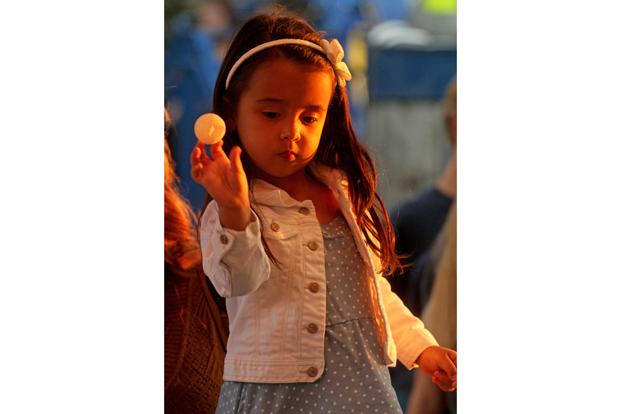 Izabella Pineda, 3, aimed carefully to try to win her family a goldfish.