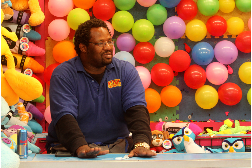 Quinton Hill worked the popular balloon dart booth at this year's Southwest Fall Fest.