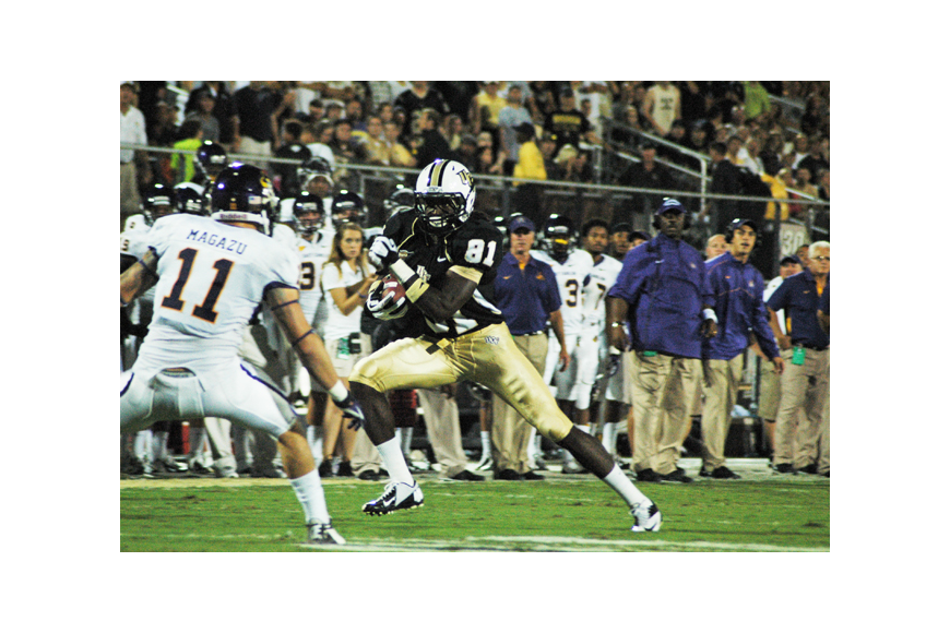 Photo by: Isaac Babcock - Freshman receiver Breshad Perriman evades defenders during UCF's 40-20 win over East Carolina Oct. 4.