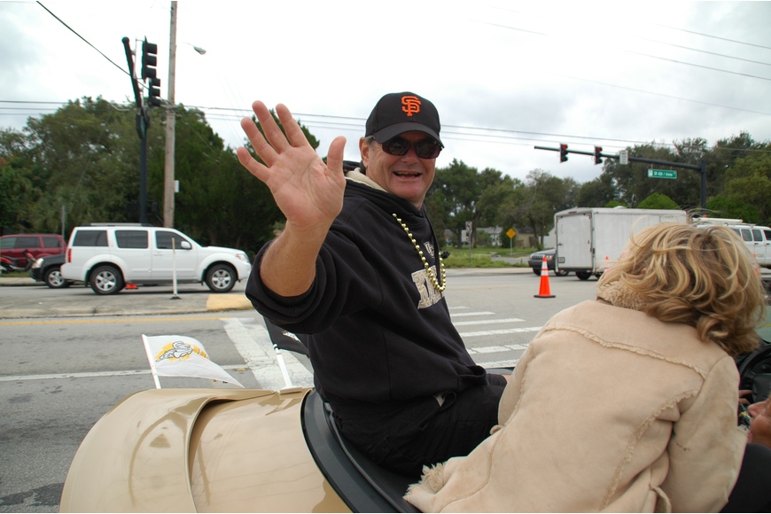 Photo by: Isaac Babcock - Former Florida Sen. Lee Constantine roots for the San Francisco Giants during the Goldenrod Parade. Constantine is running for a seat on the Seminole County Commission.