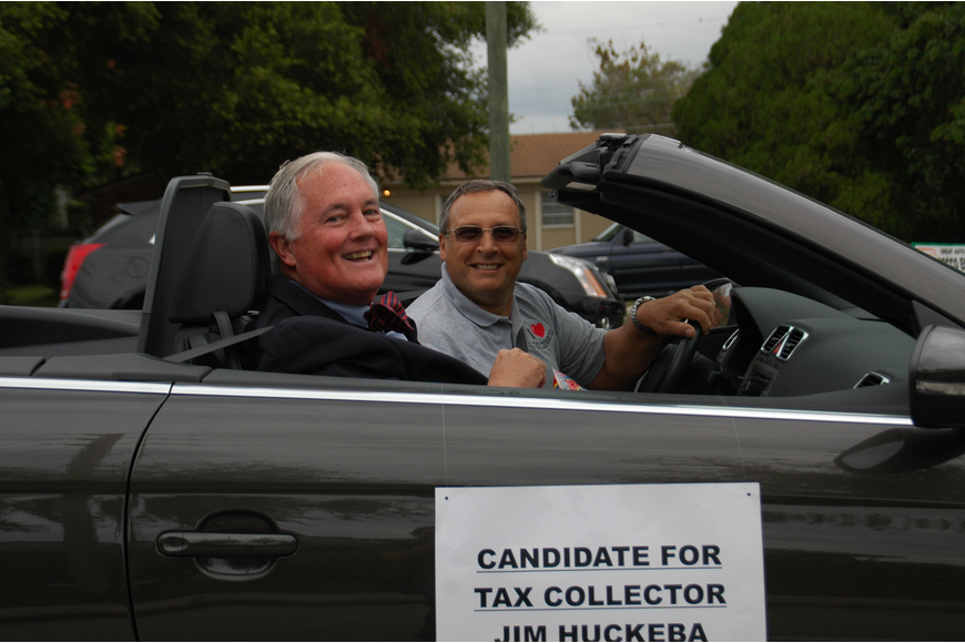 Photo by: Isaac Babcock - Gerry Marino drives Orange County Tax Collector candidate Jim Huckeba.
