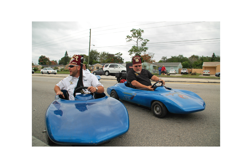 Photo by: Isaac Babcock - Goldenrod Shriners speed down Aloma Avenue.