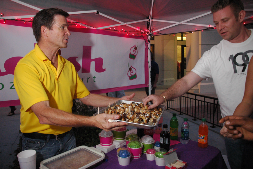 Photo by: Isaac Babcock - Delish Frogen Yozurt's Steve Danaher gives out Chewy Lewy topping at the First Friday Charity Festival in Baldwin Park May 4.