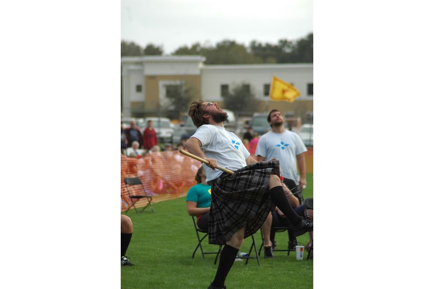 Photo by: Isaac Babcock - Isaac Burchett celebrates after setting a lightweight sheaf toss world record at the Central Florida Scottish Highland Games Jan. 19.