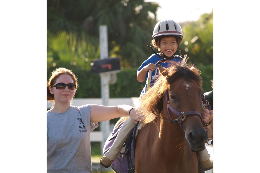 Photo courtesy of Freedom Ride - Disabled people connect with horses at Freedom Ride therapeutic horseback riding, which has volunteers and riders from across Central Florida.