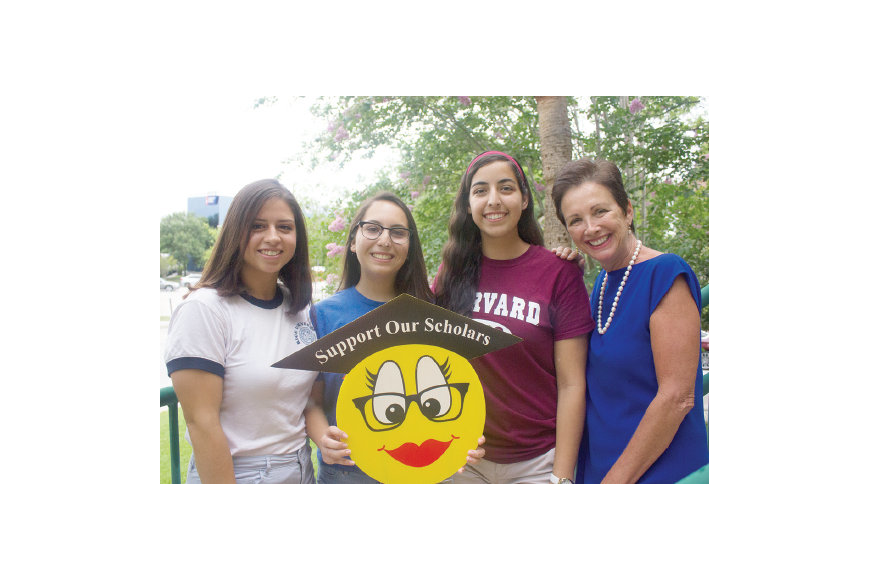 Photo by: Sarah Wilson - College bound students Alicia Cotto, left, Dara Parada, center, and Amanda Gomez were chosen to receive help from Winter Park's Support our Scholars program, founded by Susan Johnson, right.