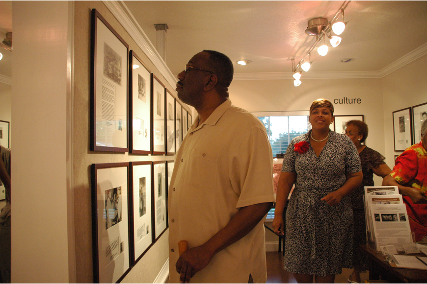 Photo by: Isaac Babcock - A visitor admires Hannibal Square Heritage Center's new exhibit, which tells the story of west side Winter Park and the everyday people who made a big difference in the city.