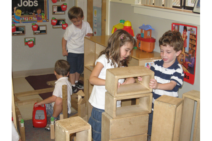 Photo by: Karen McEnany-Phillips - Sam Bermbaum and Kayla Gould, at right, play with big blocks at the JCC's Maitland campus recently. Several Maitland Jewish organizations lost funding this year.