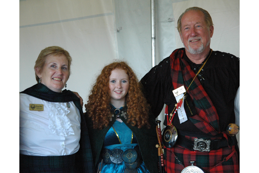 Photo by: Isaac Babcock - Scotland's Caitlyn Boyd with Margo and Robert Miller.