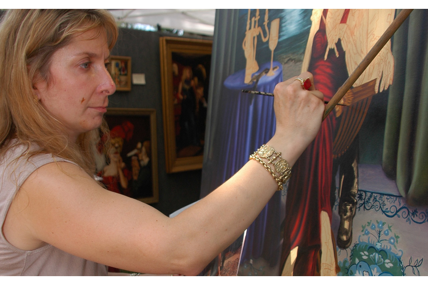 Photo by: Isaac Babcock - Lisa Russo works on an oil painting on Saturday, April 16, at the Maitland Spring Festival of the Arts.