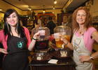 Photo by: Isaac Babcock - Jen Denhart and Cindy Harrington show some wine and tea creations at the Spice and Tea Exchange.