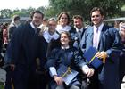 Photo courtesy of Night family - Three classmates helped hold John Michael Night, center, as he was shuffled toward Trinity Prep Principal Dennis Herron to receive his diploma at graduation, showing the most outward signs of improvement since tragedy ...