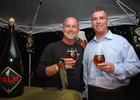 Photo by: Isaac Babcock - Serving up holiday cheer, beer distributors Chuck Hatcher from Schenck Company and Chris Graves from Latis Imports smile for the camera at the Taste of Maitland Monday night.