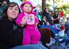 Photo by: Tina Russell - Nicole Knapp, 30 and Melanie, 8 months, wait for the 58th annual Winter Park Christmas Parade to start on Dec. 4.