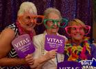 Pamela, Mary Sherman and Shirley Strader decked out in crazy props for the Vitas photo booth.